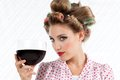 Retro woman with wine attractive holding red glass looking at camera Stock Image