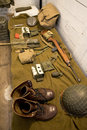 Retro wwii bunk and soldier equipment a for a his items include helmet gun rifle carbine grenade mess kit army boots more Stock Photography