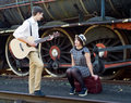 Retro young love couple vintage serenade train setting hip hipster romantic Royalty Free Stock Image
