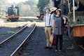 Retro young love couple vintage train setting hip hipster romantic in Stock Photography