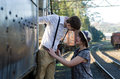 Retro young love couple vintage train setting hip hipster romantic in Royalty Free Stock Photography