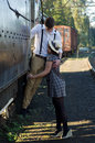 Retro young love couple vintage train setting hip hipster romantic in Stock Photo