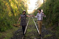 Retro young love couple vintage train tracks hip hipster romantic walking Stock Photography
