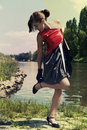 Retro young woman near the river Royalty Free Stock Photo