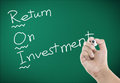 Return on investment with hand writing Royalty Free Stock Photos
