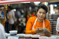 Returning the change at the night market in hua hin thailand – january thai woman returns a food stall famous Royalty Free Stock Images