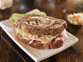 Reuben sandwich with kosher dill pickle close up photo of a shot selective focus Stock Images
