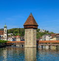 The Reuss river, Water Tower and Chapel Bridge in the city of Lu