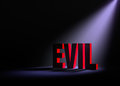 Revealing evil angled spotlight backlighting and red on a dark background Royalty Free Stock Photo