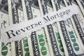 Reverse mortgage paper message on assorted cash Stock Image