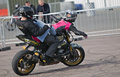 Reverse stunt poddington uk april a pair of motorcycle riders practice their routine in front of a casual crowd of onlookers Royalty Free Stock Photography