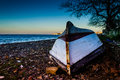 Reversed Fishermen Rowboat On Sunset Shore Royalty Free Stock Photo