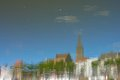 Reversed image concept: reflection of the city of Ghent Royalty Free Stock Photo