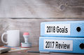 2017 review and 2018 goals. Two binders on desk in the office. Business background