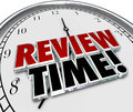 Review time clock reminder evaluation assessment words in d letters on a face to remind you to do an or as an employee or Royalty Free Stock Photos