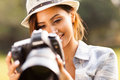 Reviewing photos camera smiling pretty woman on Royalty Free Stock Photo