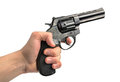 Revolver gun in hand on white background Royalty Free Stock Photo