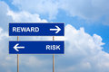 Reward and risk on blue road sign Stock Image