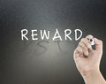 Reward and risk with hand writing Royalty Free Stock Photo