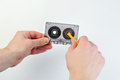 Rewind audio casette with tape on a white background Royalty Free Stock Photo