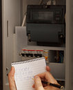 Rewriting of the electrical meter readings at home in russia close up shot Stock Photos