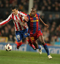Reyes of Atletico fight with Abidal of Barcelona Stock Photo