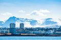 Reykjavik city in ieland beneath a mountain with snow Royalty Free Stock Image