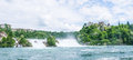 Rhine falls with blue cloudy sky Stock Photography