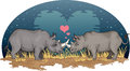 Rhinos in love two falling under a heart shaped moon africa Royalty Free Stock Photos