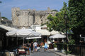 Rhodes castle greece the with its fortified walls and the shops with tourists island Royalty Free Stock Photography