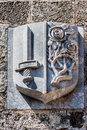 Rhodes coat of arms a on the wall a medieval building in the knights street island greece a sword and flowers Stock Photo