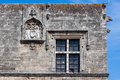 Rhodes code of arms a on the wall a medieval building in the knights street island greece Royalty Free Stock Image