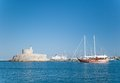 Rhodes fortress of saint nicholas mandraki harbour greece Stock Photo