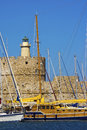 Rhodes mandraki harbour harbor with light house and yachts Stock Image