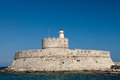 Rhodes medieval fortress of saint nicholas now the site of a lighthouse in mandraki harbour new town greece Stock Photos