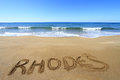 Rhodes written on sandy beach Royalty Free Stock Images