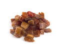 Rhubarb dried candied fruits on white background Royalty Free Stock Photo