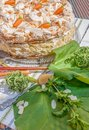 Rhubarb pie with meringue and almonds stems in the foreground Stock Photo