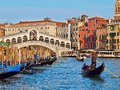 Cityscape of Venice with Rialto bridge and a gondola in front Royalty Free Stock Photo