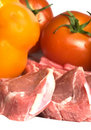 Rib lamb chops with vegetables tomato Stock Photography