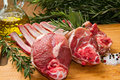 Rib lamb a group of with oil and rosemary on wood table Royalty Free Stock Photos