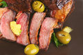 Rib's and olive on dish Royalty Free Stock Photo