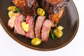 Rib's and olives close up on old style dish Royalty Free Stock Photo