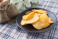 Ribbed potatoes snack on table Stock Photography