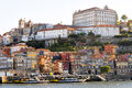 Ribeira porto view on the old part of in portugal with quaint houses by the riverside lit by early morning sunlight and boats Stock Photo