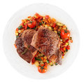 Ribeye steak with fried vegetables isolated on white background Stock Photography
