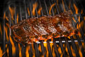 Ribs on a Flaming Hot Grill Royalty Free Stock Photo
