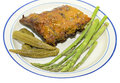 Ribs plate with vegetables a of barbecued fresh asparagus and pickled okra Royalty Free Stock Photos