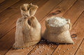 Rice in bags on a wooden table Royalty Free Stock Photo