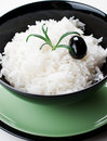 Rice in black round bowl Royalty Free Stock Photography
